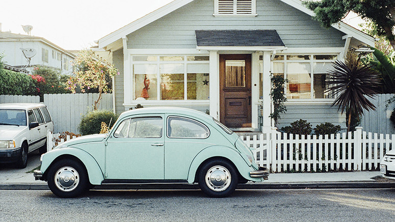 house with vw bug in front