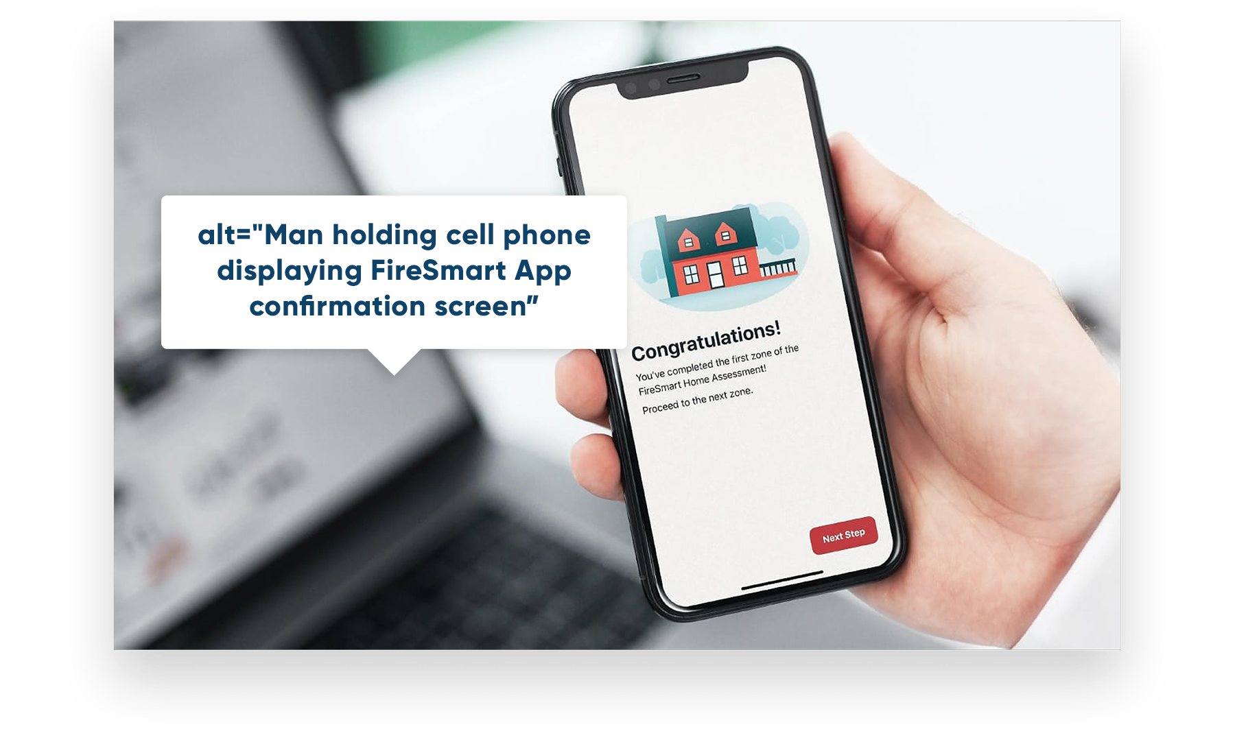 image showing an example of alternative text ie. Man holding cell phone displaying FireSmart App confirmation screen