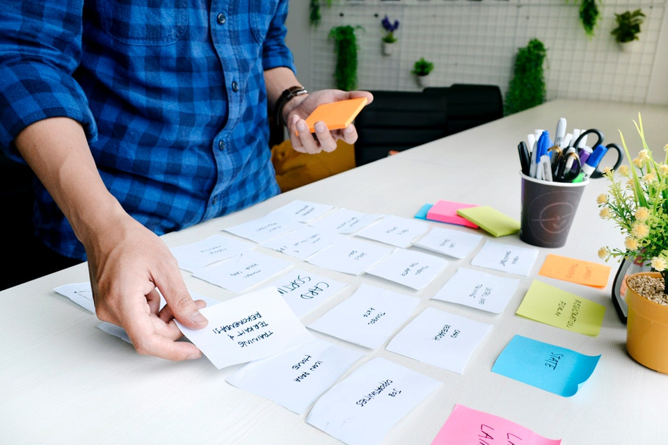 person sorting sticky notes